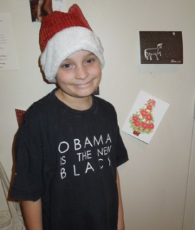 My less-sick kid on Christmas Day. He handed out presents while his sister moaned and groaned (and cried).