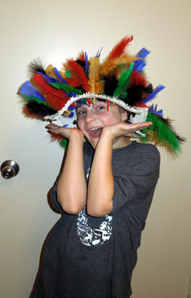 A crazy hat project for school: There are 100 feathers in that hat. Call it macaroni!